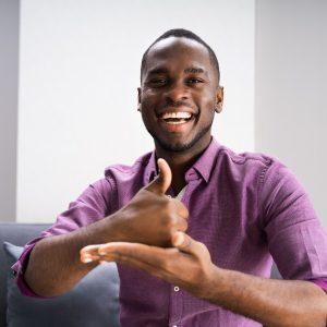 African American Deaf Man Using Sign Language